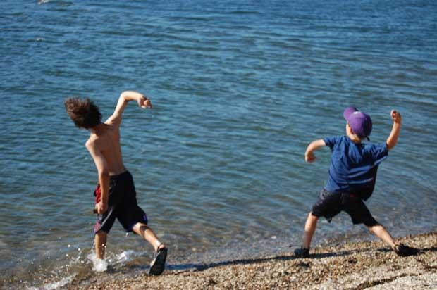 boys throwing stone