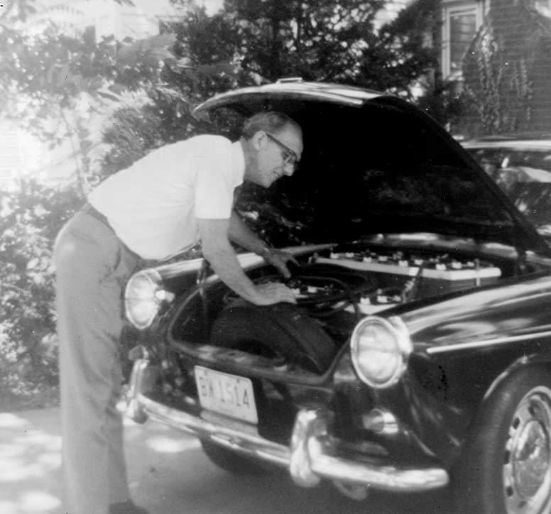 Grandpa Under the Hood of His Electric Car